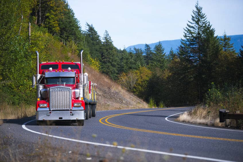 Red Kenworth W900 Driving on Sunny Day