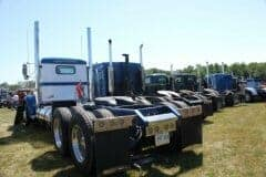 Rear View of Big Rigs at Truck Show