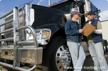 2 Truckers Talking by their Truck