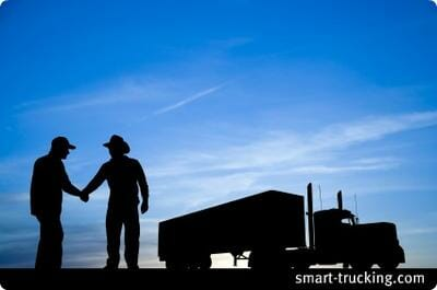 2 Old Time Truckers Shaking Hands