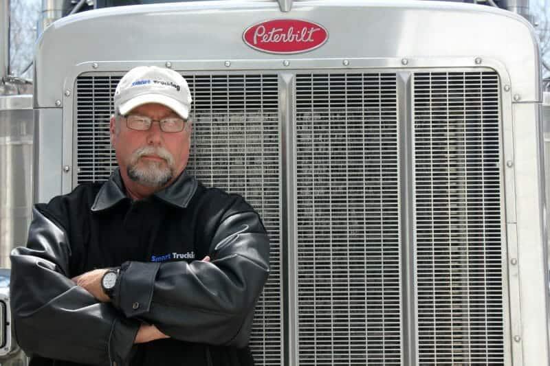 Owner Operator Trucker standing by Peterbilt Big Rig