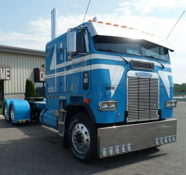 Blue Freightliner Cat Powered