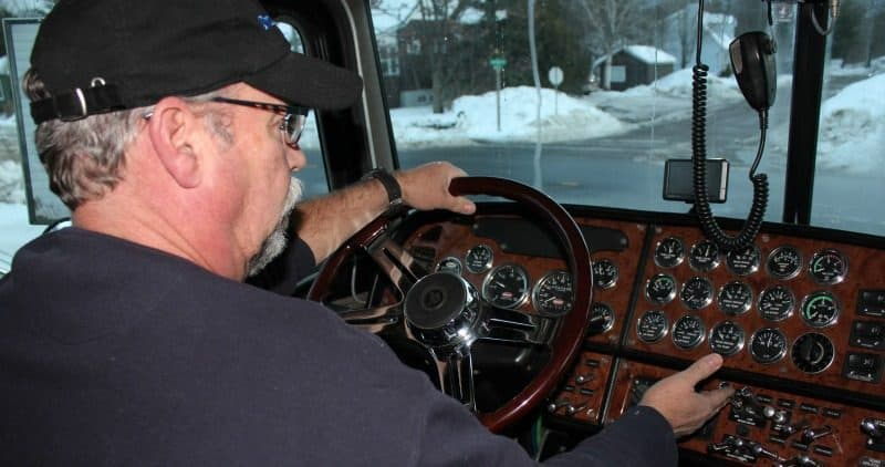 Truck Driver and Dashboard of Big Rig